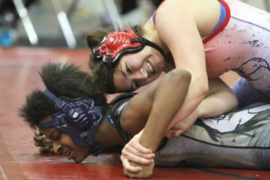 Oak Ridge's Rachel Bates finished first in the 148-lb. weight class at The Woodlands Invitational Saturday. To view or purchase this photo and others like it, visit HCNpics.com.