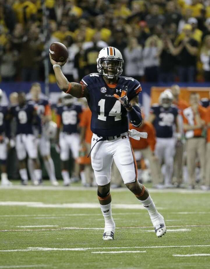 Auburn quarterback Nick Marshall operates against Missouri in the SEC title game.