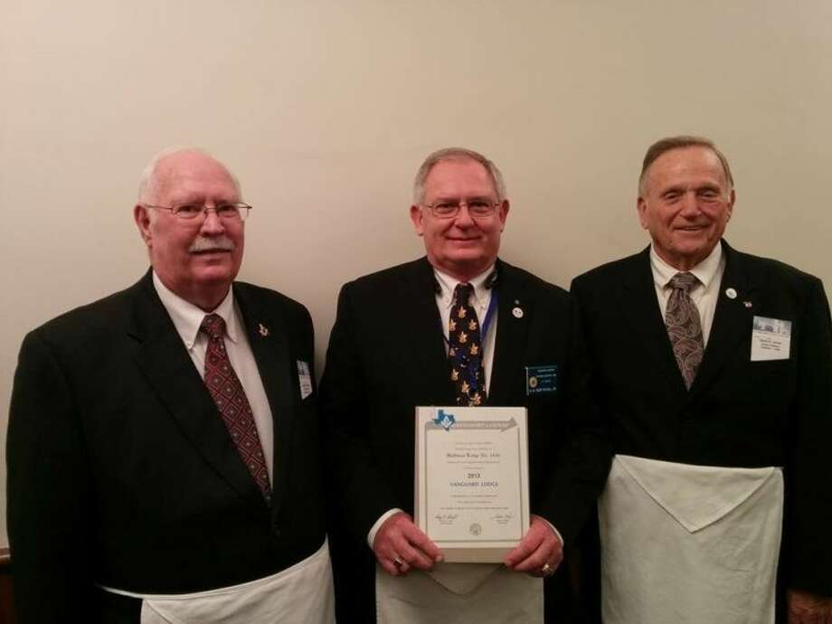Worshipful Master Bob Royall. center; Senior Warden Ray Ricks, left; Junior Deacon James Jordan, right.