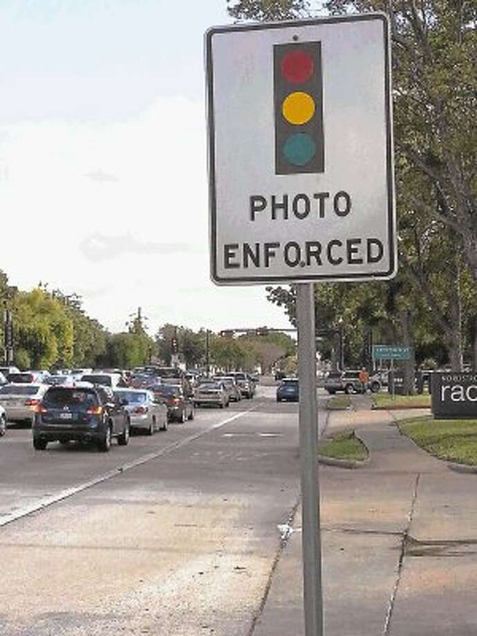 A sign cautions drivers to properly observe the traffic signals while going through the intersection of Highway 6 and Lexington Boulevard. / @WireImgId=2651431