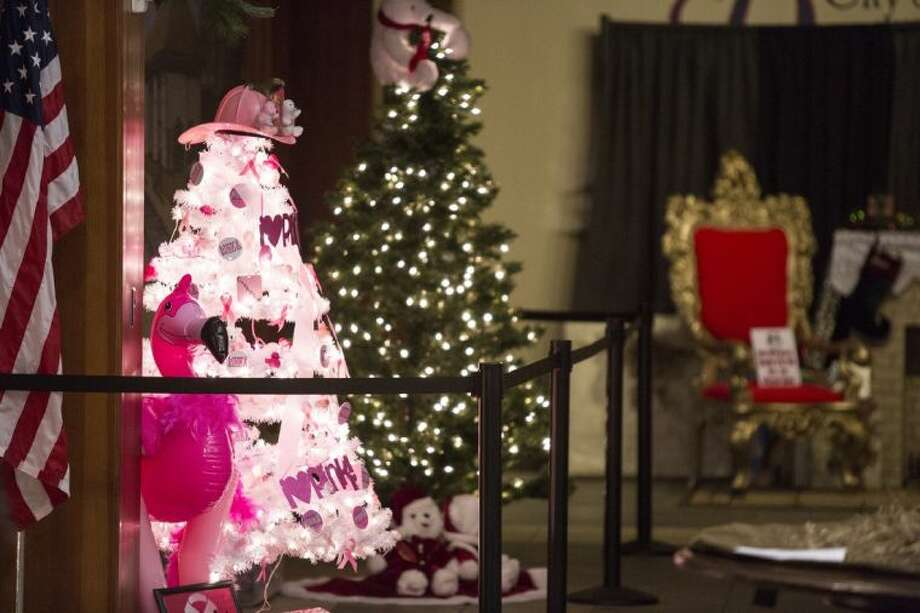 The Dayton Community Center is adorned by dozens of trees for the Fourth Annual Christmas Tree contest. The proceeds from this event will be used for toys, backpacks, jackets, hats and bikes for needy children of Liberty County. Photo: ANDREW BUCKLEY