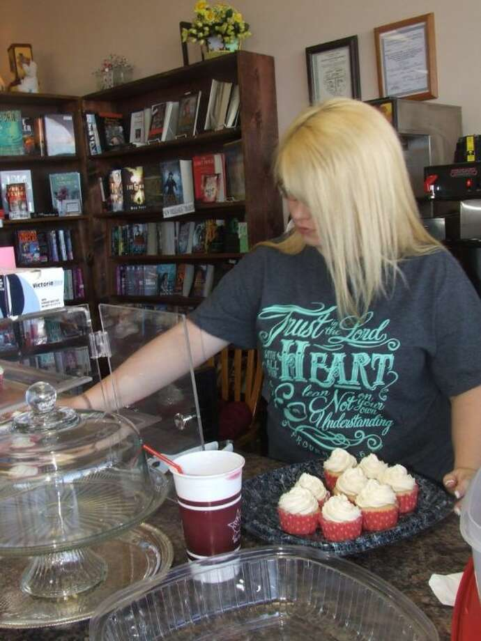 Heather Bracksieck prepares to display cupcakes for customers at the Book Attic.
