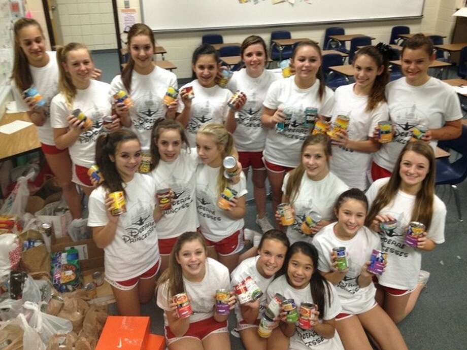 Doerre Cheerleaders collect more than 1, 000 canned goods for those in need this season. Photo: Submitted Photo
