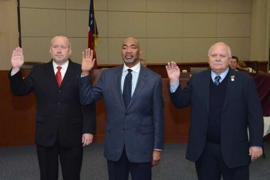 Board members (from left) Don Ryan, Dr. John Ogletree Jr. and Bob Covey take the oath of office for Positions 6, 5 and 7, respectively, during a special-called meeting on Thursday. Photo: Submitted Photo