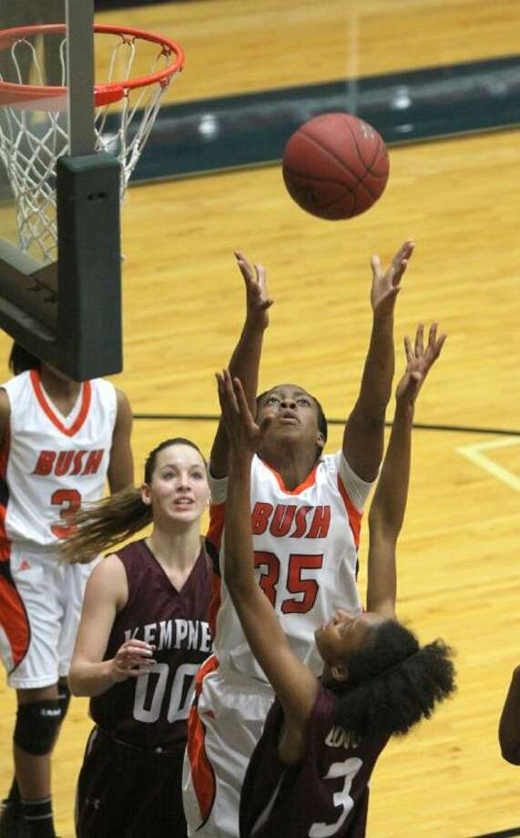 Bush's Faith Ohanta goes up for a rebound over Kempner's Tierra Roberson during a district game last year at Wheeler Field House. The Lady Broncos take an 11-3 record into District 23-5A play. Photo: Alan Warren