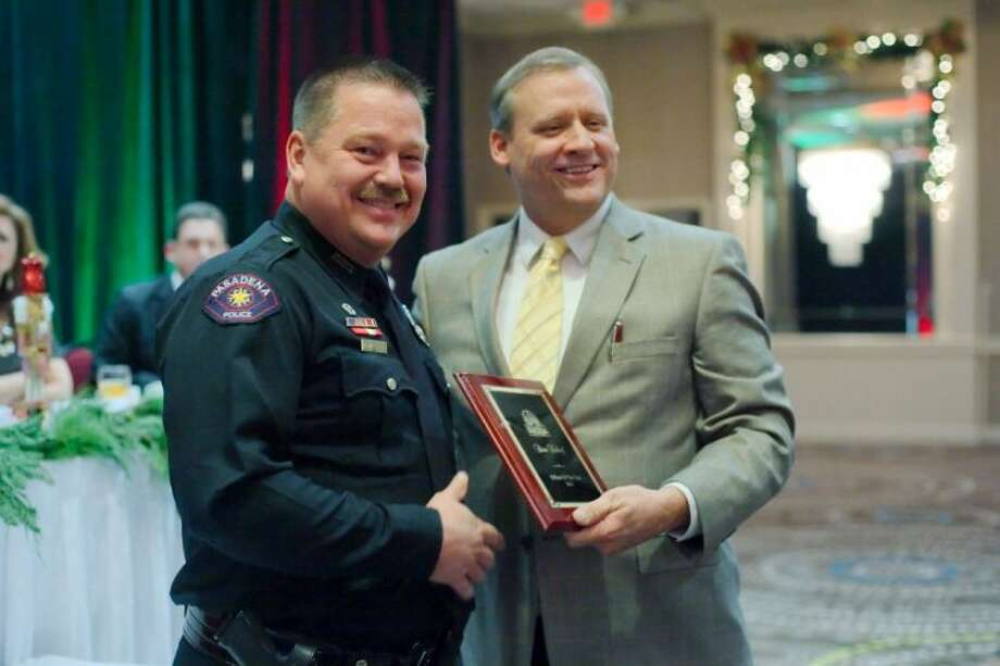 "Officer Brian Kelldorf of the Day Shift Patrol was presented with the Officer of the Year Award by Police Chief Michael Thayer for ""valiant and compassionate acts"" at the Chamber of Commerce Awards Banquet Thursday (Dec. 5). Photo: KIRK SIDES"