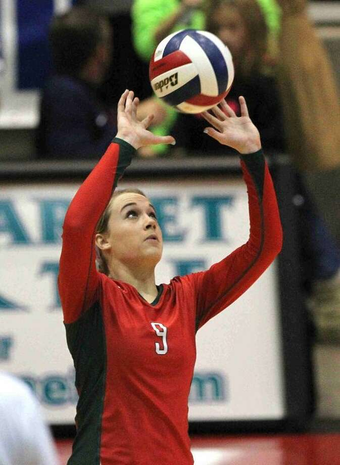 The Woodlands' Courtney Eckenrode (9) sets up the offense during a Class 5A UIL Volleyball State Championship semifinal game in Garland, Texas. Photo: Staff Photo By Jason Fochtman