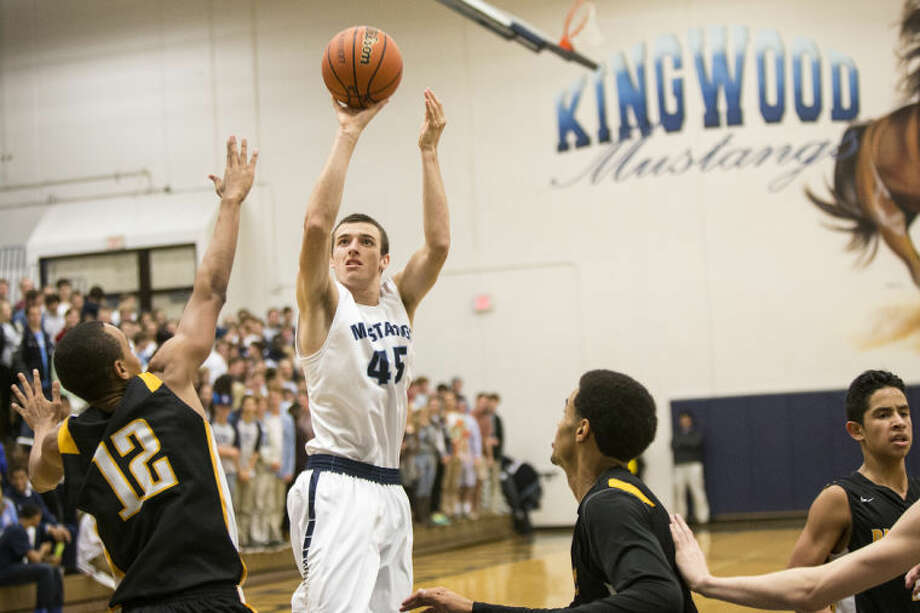 The Mustangs' Grant Hazle shoots during Kingwood's victory over Klein Oak on Dec. 10, 2013, at Kingwood High School. (Photo by ANDREW BUCKLEY/The Observer) Photo: ANDREW BUCKLEY