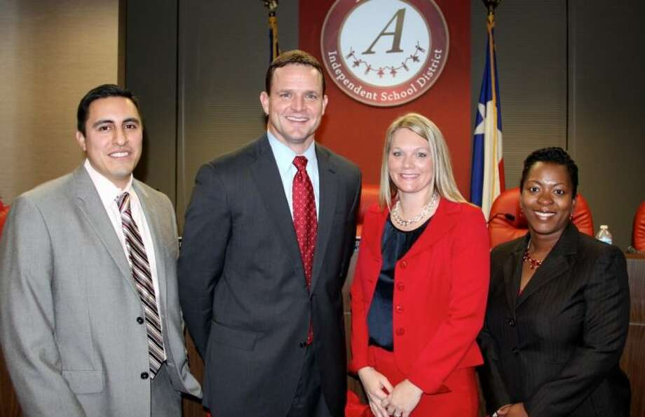 Pictured left to right: Bobby Martinez, Dr. Fred Brent (Superintendent of Schools), Elizabeth Garcia and Krystal Hawks. Photo: Courtesy Alvin ISD