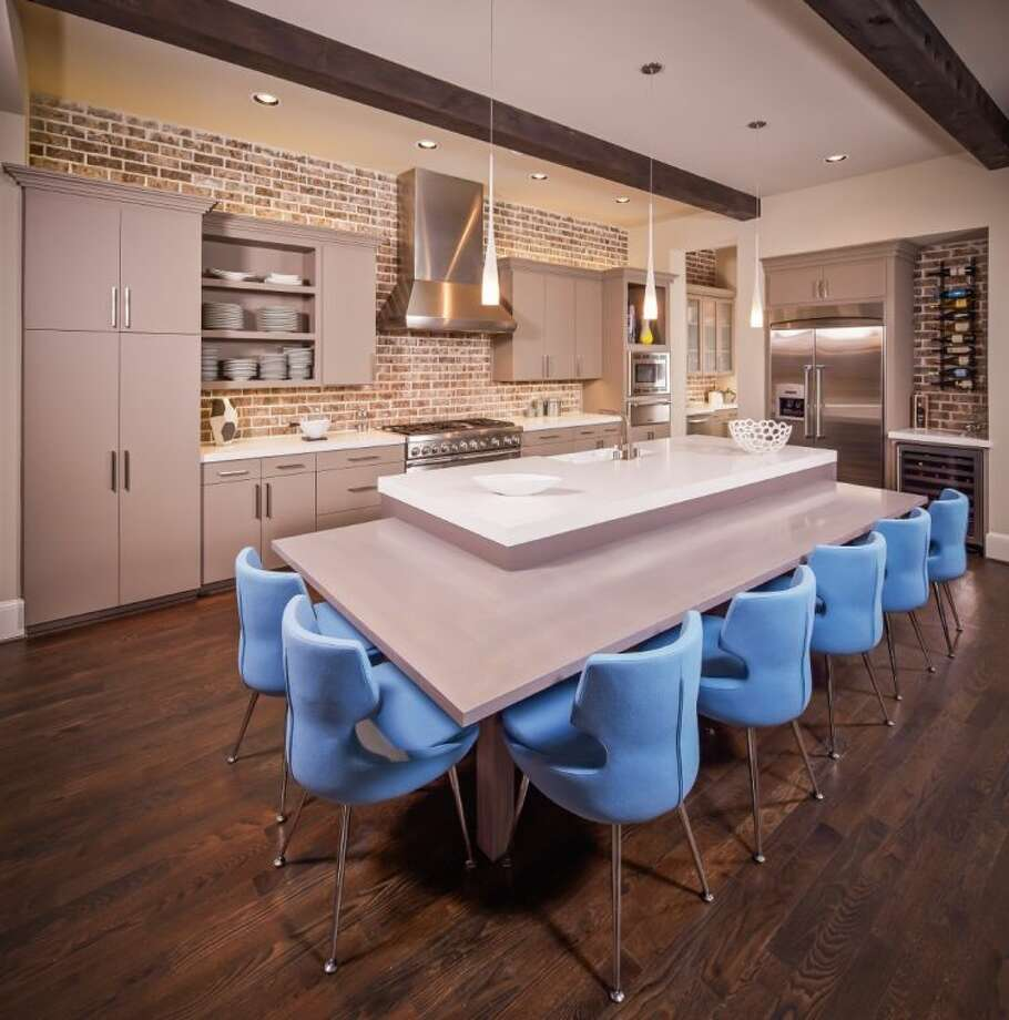 Members of the Custom Builders Council are seeing kitchen islands getting bigger and designed in new and interesting shapes, allowing for more seating and easier conversations. Photo: Jamestown Estate Homes