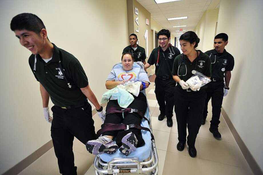 San Jacinto College students participating in the recent allied health simulation exercises included, from left, Gerardo Parga, mock patient Kasey Richmond, Millard Williams, Brandon Rodriguez, Ana Aguirre, and Omar Morales. Photo credit: Rob Vanya, San Jacinto College marketing, public relations, and government affairs department.