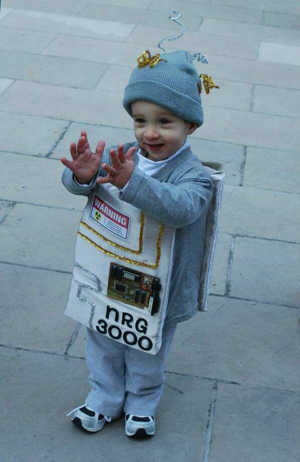 You kids would be as happy as this little boy if they got to wear a robot costume this epic.