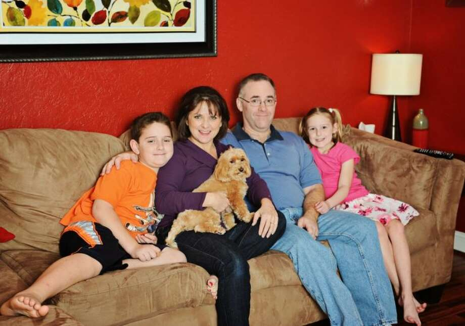 From left to right, Nicholas Serena, author Toni Serena, family dog Lola, Bob Serena, and Charlotte Serena. Photo: Submitted