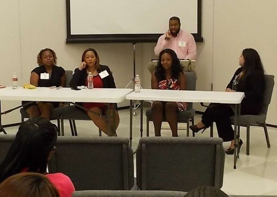 Former FBISD students (seated from left) Charity, Baroness, Shekina, Shelly and Fred (back seat) led a Teen Panel to offer conference participants support and advice in pursuing their goals. Photo: Courtesy FBISD