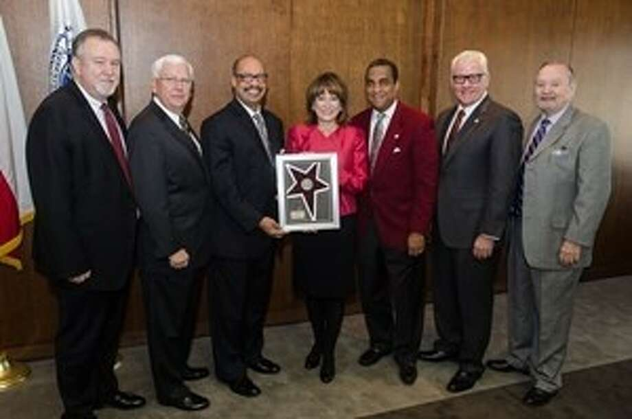 From the right: Port Commissioners Stephen H. DonCarlos and John D. Kennedy; Dr. John Rudley, President of Texas Southern University, presenting Port Commission Chairman Janiece Longoria with a plaque recognizing the Port of Houston Authority as one of TSU's Legacy Partners of the Year; Port Commissioners Theldon R. Branch III, Dean E. Corgey and Roy D. Mease. Photo: Courtesy Port Of Houston Authori