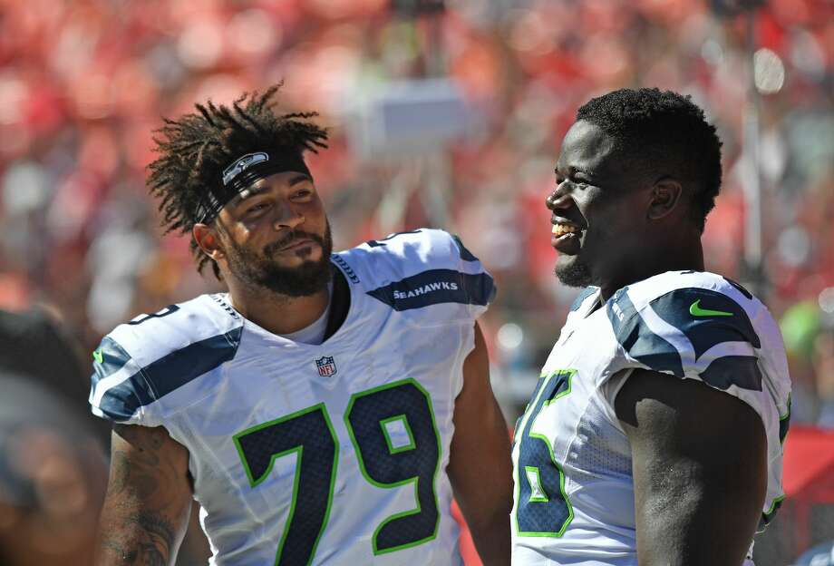 The San Francisco 49ers have reportedly signed restricted free agent tackle Garry Gilliam (left) to an offer sheet, which gives the Seahawks five days to match. Photo: Peter G. Aiken/Getty Images