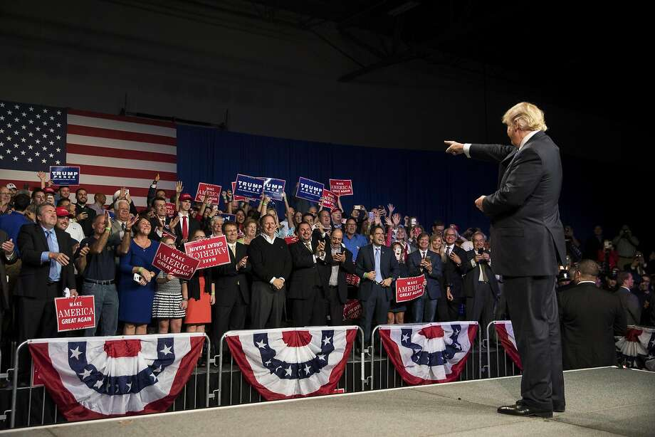 GOP presidential candidate Donald Trump greets supporters at a campaign event Friday night at the Suburban Collection Showplace in Novi, Mich. Photo: DAMON WINTER, NYT