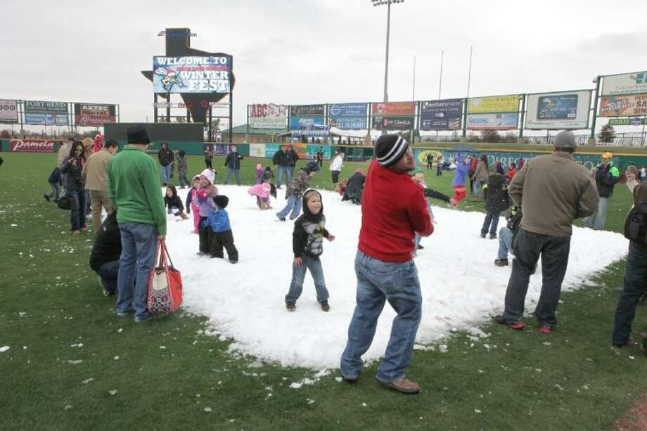 Families enjoys the snow in the outfield at the Sugar Land Skeeters Winter Fest at Constellation Field on Sunday, Dec. 8. Photo: Alan Warren