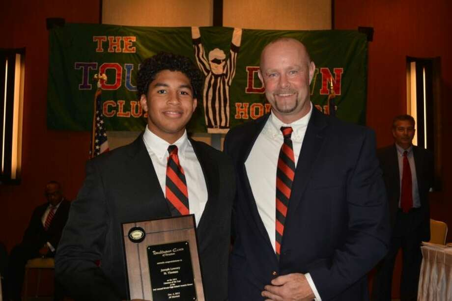 St. Thomas senior Joseph Lowery, left, and St. Thomas head football coach Tim Fitzpatrick were both honored last week by The Touchdown Club of Houston when the club gave out its private schools awards for the recent football season. Lowery was named the Lineman of the Year, giving a St. Thomas student that award for the second year in a row after Parker White won it in 2012. Fitzpatrick meanwhile was named the Private School Coach of the Year for leading the Eagles to 10 wins and the second round of the TAPPS playoffs for the second consecutive year.