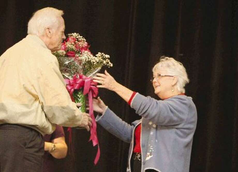 Administrative Assistant Patti Werner accepts the award for Montgomery County Employee of the Year from County Judge Alan B. Sadler during the county's annual Christmas party at the Lone Star Convention Center Tuesday. / Conroe Courier