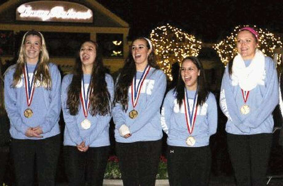 The Woodlands varsity volleyball players laugh during a ceremony honoring the team's state and national titles on Wednesday at Market Street in The Woodlands. / Conroe Courier