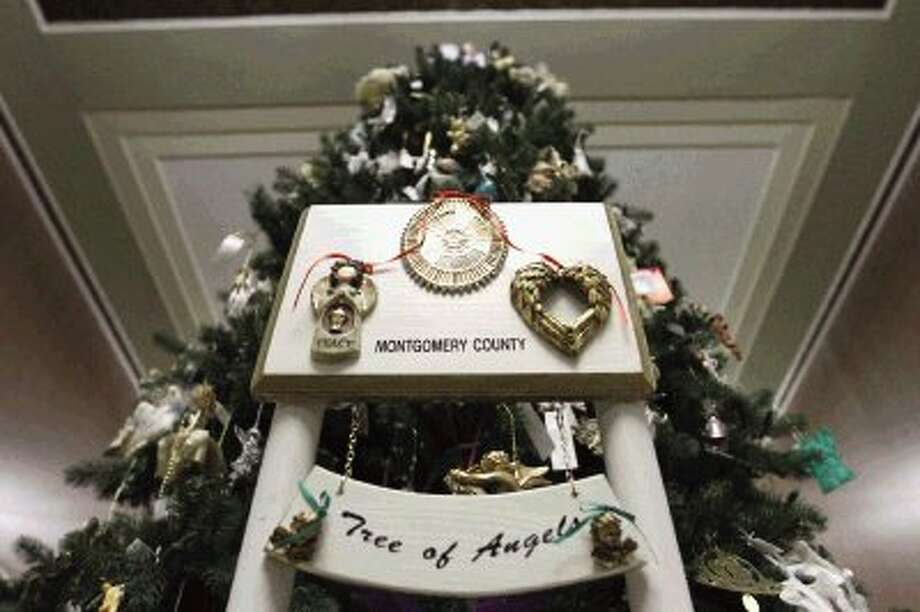 Friends and families of victims of violent crime came together to remember their loved ones during the 17th Annual Montgomery County Tree of Angels dedication ceremony at the Montgomery County Courthouse Thursday. / Conroe Courier