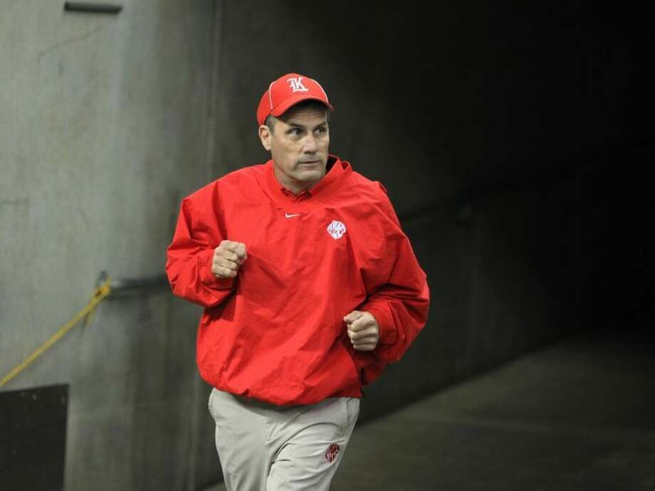 Katy coach Gary Joseph runs onto the field at Reliant Stadium during the Tigers' 56-14 victory against Manvel in the Class 5A Division II Region III final. Joseph was voted 2013 Coach of the Year by the Touchdown Club of Houston. Photo: Alan Warren/HCN