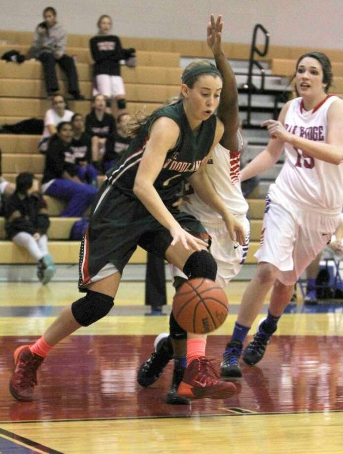 The Woodlands forward Nicole Iademarco dribbles in the paint during a District 14-5A game against Oak Ridge on Friday at Oak Ridge High School. The Lady Highlanders won, 67-35. To view or purchase this photo and others like it, visit HCNpics.com.