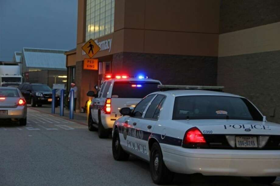 Pearland Police cars were parked outside the east side Wal-mart on Dixie Farm Road and Broadway after the bank branch inside the store was robbed Wednesday (Dec. 11). Photo: KRISTI NIX