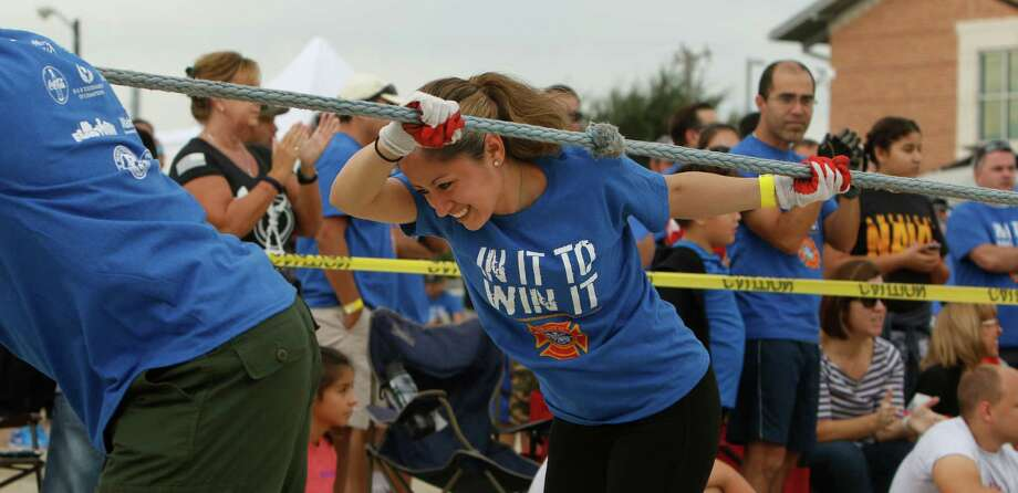 Best Friends takes their turn in the tug of war challenge at the 11th Annual Special Olympics Texas F ire-Truck Pull held at the San Antonio Fire Training Academy benefiting the Special Olympics of Texas on Saturday, October 1, 2016. Photo: Ron Cortes