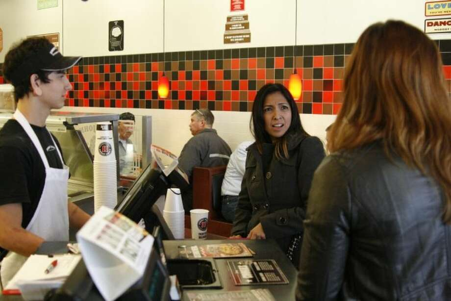 Marisol Pina was surprised at Jimmy John's in Humble by Third Coast Bank employees who are surprising customers by purchasing their meals through their holiday Random Acts of Kindness program.