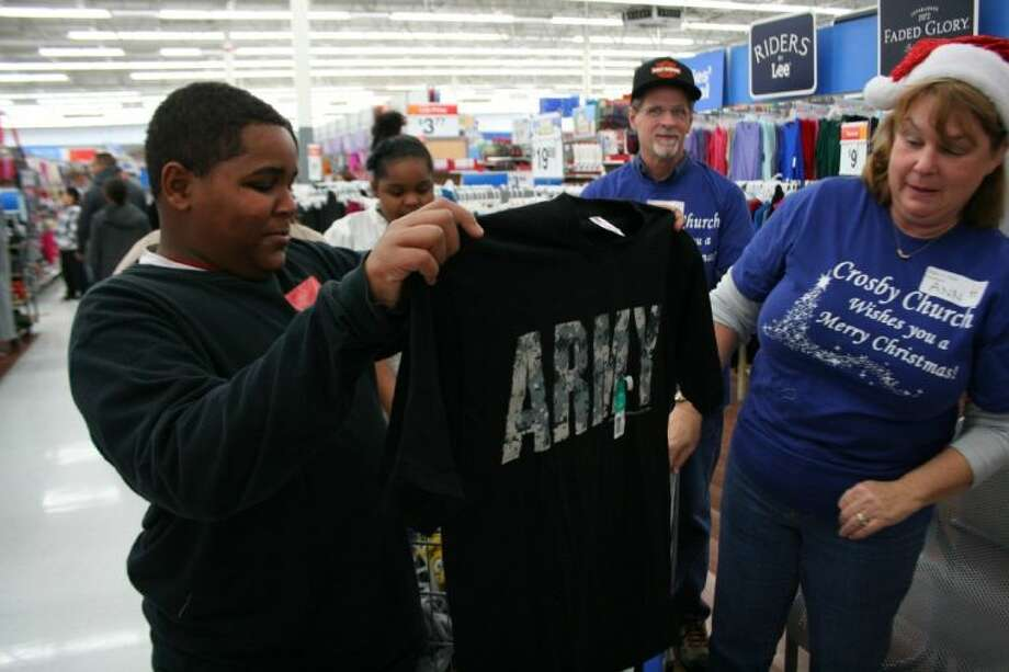 C.J. Landry shows off his newly selected Army T-shirt granted by the Crosby Care Clothe-a-Child project. Photo: Nate Brown