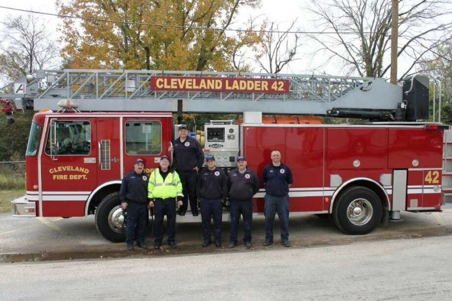 Cleveland Fire Department added a new ladder truck to its fleet in late 2013. The cost for the truck was minimal. Pictured left to right are Cleveland firefighters Travis Strickland, Chief Brian McNevin, Michael Bortz, Mark Lovell, John Murphy and Capt. Bryan Harvey. Photo: VANESA BRASHIER