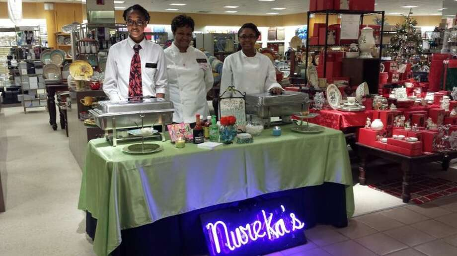 The smells of jambalaya and a Creole seafood pasta wafted throughout the Dillard's Department Store as Humble's Nureka's Taste of New Orleans served up samples to guests during their VIP shopping experience for customers Dec. 8, 2013.