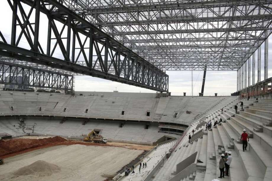 A construction crew works on the Arena da Baixada on Saturday in Curitiba, Brazil. Workers went on strike this week over late pay. The stadium was due to be completed by Dec. 31 but is not expected to be complete until mid-February.