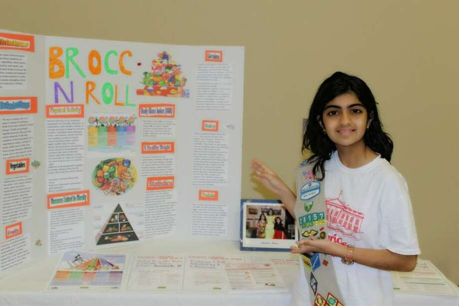 "Cadette Girl Scout Devanshi Udeshi next to a display from her ""Brocc N Roll"" project. Photo: Submitted Photo"