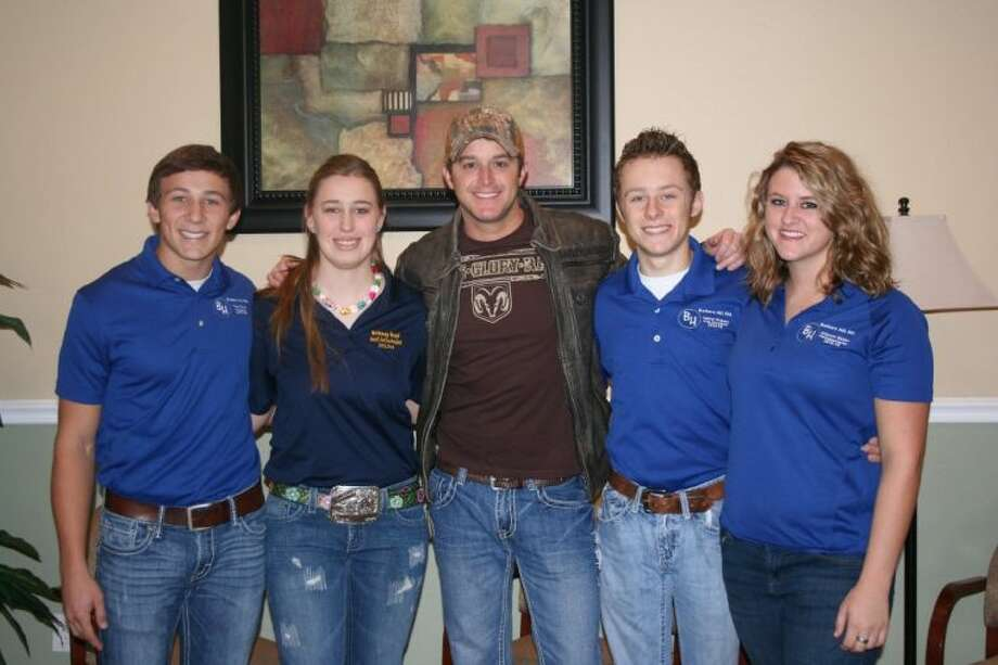 Country singer Easton Corbin performed a concert at Eagle Heights Church, located on the outskirts of Dayton, for students from several local FFA chapters, including Dayton and Shepherd ISDs. Many district officers from Barbers Hill FFA were given the chance to meet the singer, including Tyler Davis, Brittney Boyd, Tanner Dickens and Julianne Weldon. Photo: STEPHANIE BUCKNER