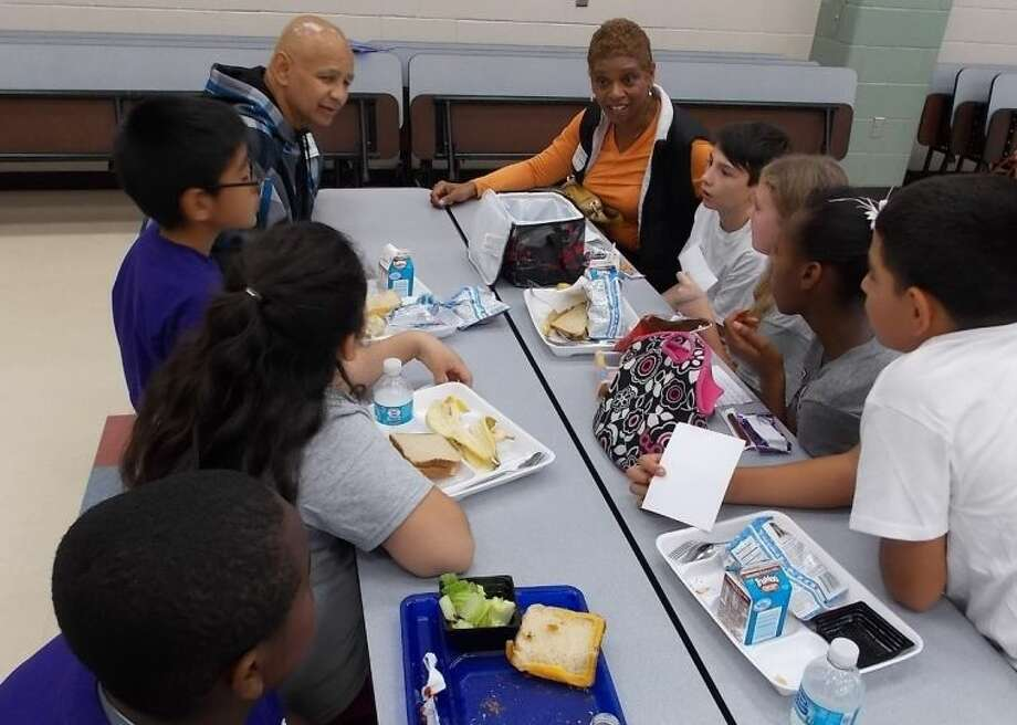 Married couple Michael Smith and Christine Criner (shown at head of table) were happy to speak to students about their college experiences. Photo: Courtesy FBISD