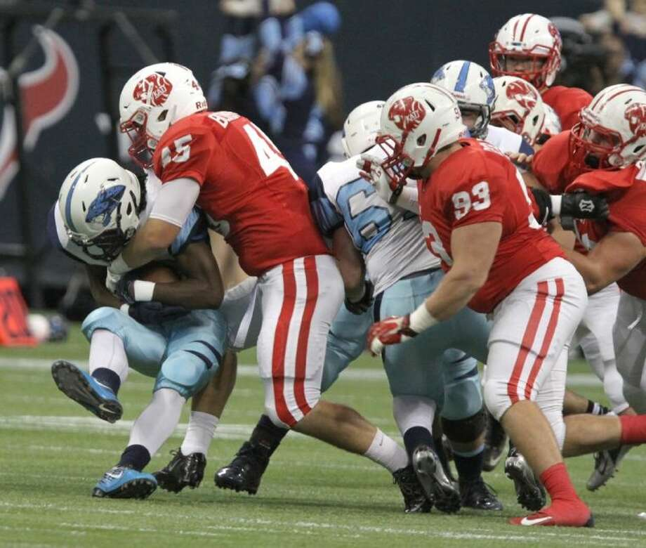 Katy's Jake Blomstrom stops Johnson's Braedon Williams during State Semifinals game at Reliant Stadium in Houston on Saturday, Decemeber 14, 2013. Katy won the game 52-0. Photo: Alan Warren