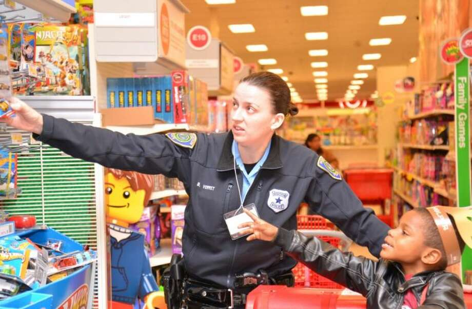 "Houston police officers were paired with children from Child Protective Services last week for ""Shop with a Cop"" at a local Target store."