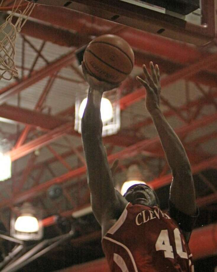 Cedric Gambrell (40) of Cleveland goes up high to hit a short shot in the lane for Cleveland against Big Sandy in the championship game Saturday. Cleveland won over Big Sandy in a thriller, 60-59, to claim the Splendora Tournament championship. Photo: MARK ANDERSON