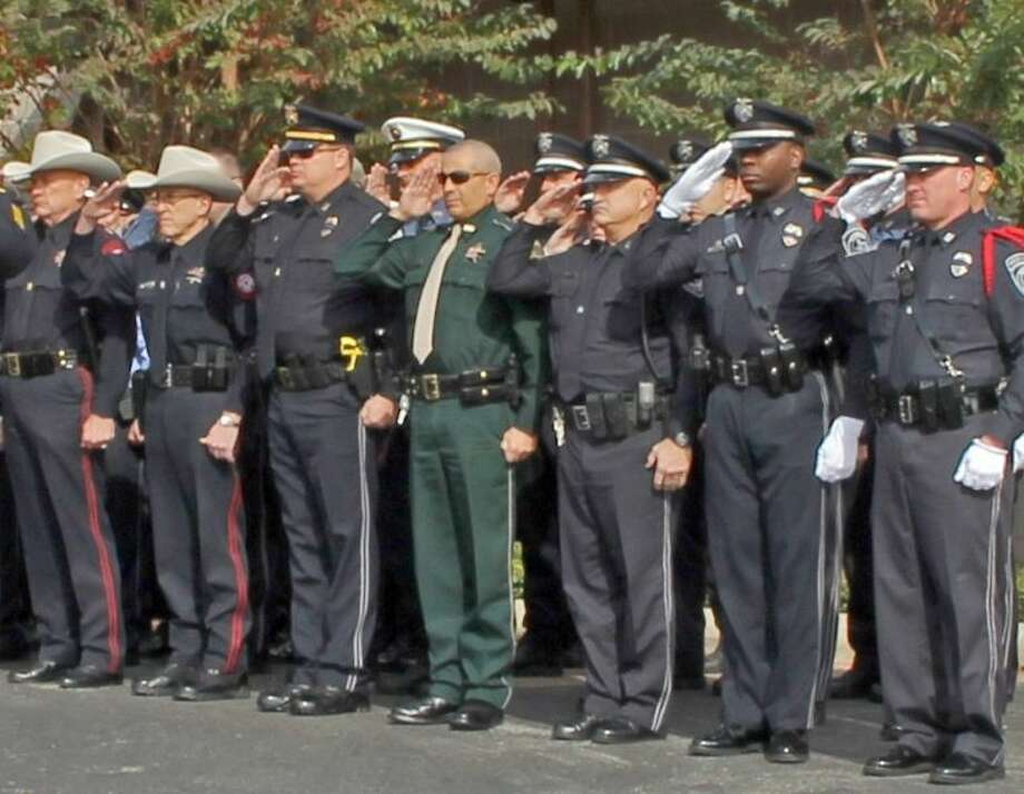"""Officers from law enforcement agencies throughout the League City and Pearland area gathered to pay tribute to League City Police Officer Carl Stoddard at a memorial service held at Saint Helen's Catholic Church Thrusday (Dec. 12). A resident of Pearland known to his friends and family as """"Jasper"""", Officer Stoddard is survived by his wife of 16 years, Melissa (Lisa), daughter Victoria Marie and son Ryan. Photo: KRISTI NIX"""