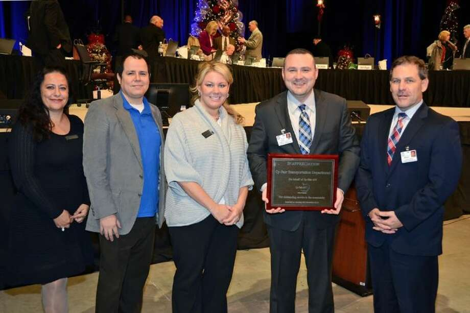 From left, Cy-Fair American Federation of Teachers (AFT) representatives Lauren Duperray, Mike Garcia and Nikki Cowart present a plaque to director for transportation Bill Powell and assistant superintendent for support services Matt Morgan for their outstanding service to the community through the holiday food and coat drive. Photo: Submitted Photo