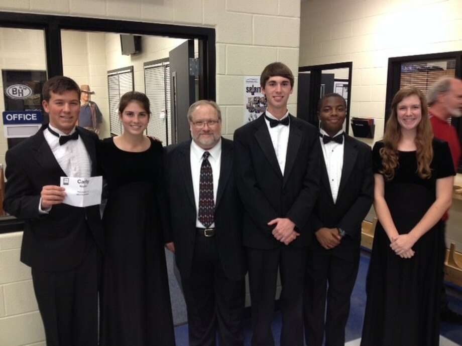 2013 Region Wind Ensemble Band students from Kingwood Park High School are pictured with their guest conductor, Matthew McInturf, the Director of Bands at Sam Houston State University are Mason Carr, Carly Naylor, Mr. McInturf, Ben Kelly, Kerry Williams and Amanda Rose.