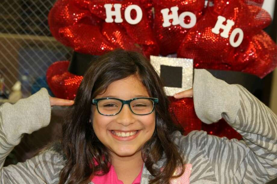 Keller Middle School fifth-grader Mitzi Cummings shows off her new eyewear, courtesy of the See to Succeed Program. Photo: Bruce Stone
