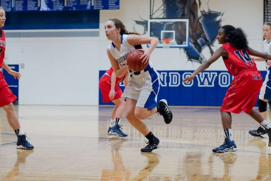 Friendswood's Caitlin Modesett drives to the basket in a recent non-district game. Modesett has helped the Lady Mustangs to a 2-0 record in district. Photo: KIRK SIDES