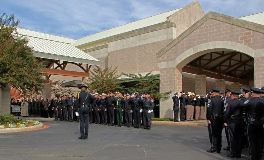 Hundreds of law enforcement officers, including many from the Pearland Police Department gathered to pay their respects to League City Police Officer Carl Stoddard of Pearland. Stoddard passed away in November after a two-year battle with a rare form of cancer. Photo: KRISTI NIX