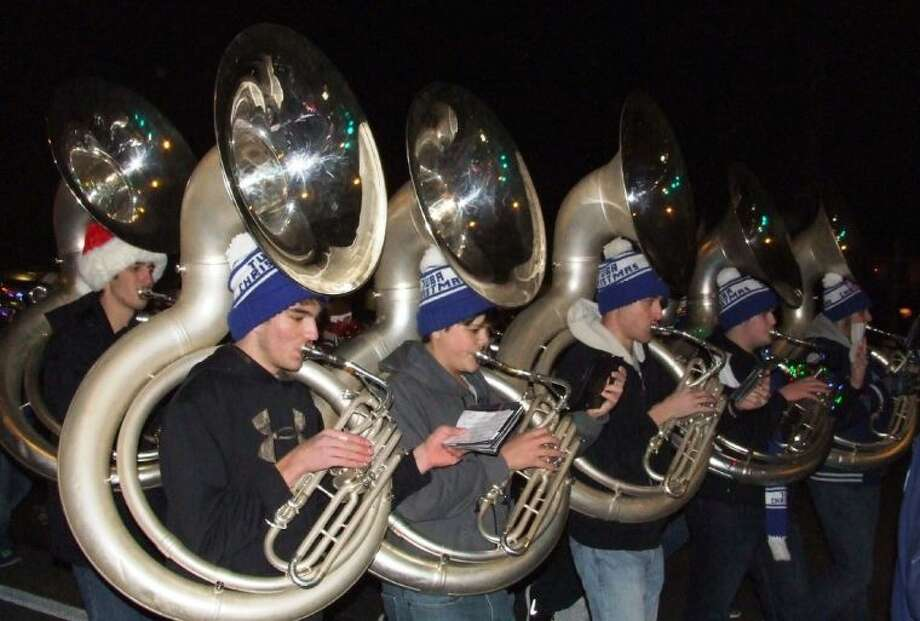 Tubas helped give the Friendswood High School Marching Band an award-winning entry in the Annual Lighted Christmas Parade. Photo: JEFF NEWPHER