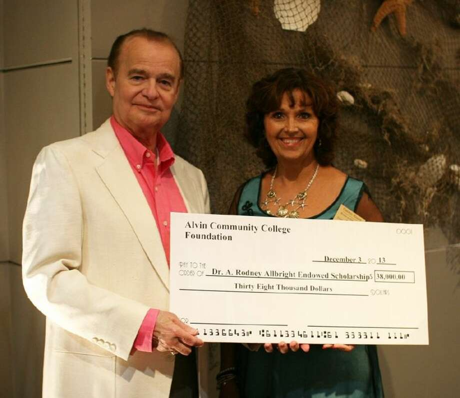 ACC Foundation Board Member Cheryl Knappe, right, presents President Dr. Rodney Allbright with a $38,000 check which will establish the Dr. A. Rodney Allbright Endowed Scholarship. The amount is to recognize Dr. Allbright's 38 years as president at ACC. The check was presented during the 14th annual Foundation Christmas Gala on December 3. Photo: Courtesy ACC