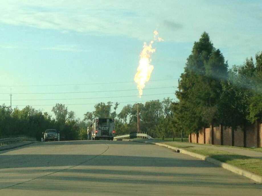 A massive flare shoots into the sky on Nov. 15, in a picture taken by Sugar Land Sun reader Scott Klamert at 5300 Elkins Rd. Klamert said the flare was visible all the way from U.S. 59. Photo: Photo Courtesy Of Scott Klamert